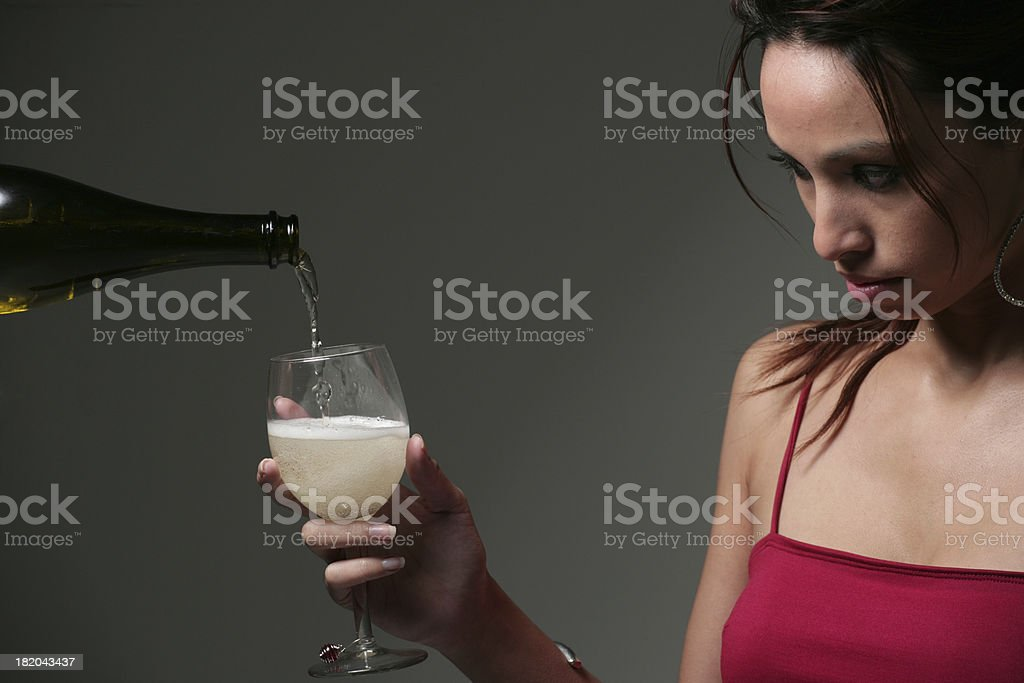 Pouring a glass of champagne royalty-free stock photo