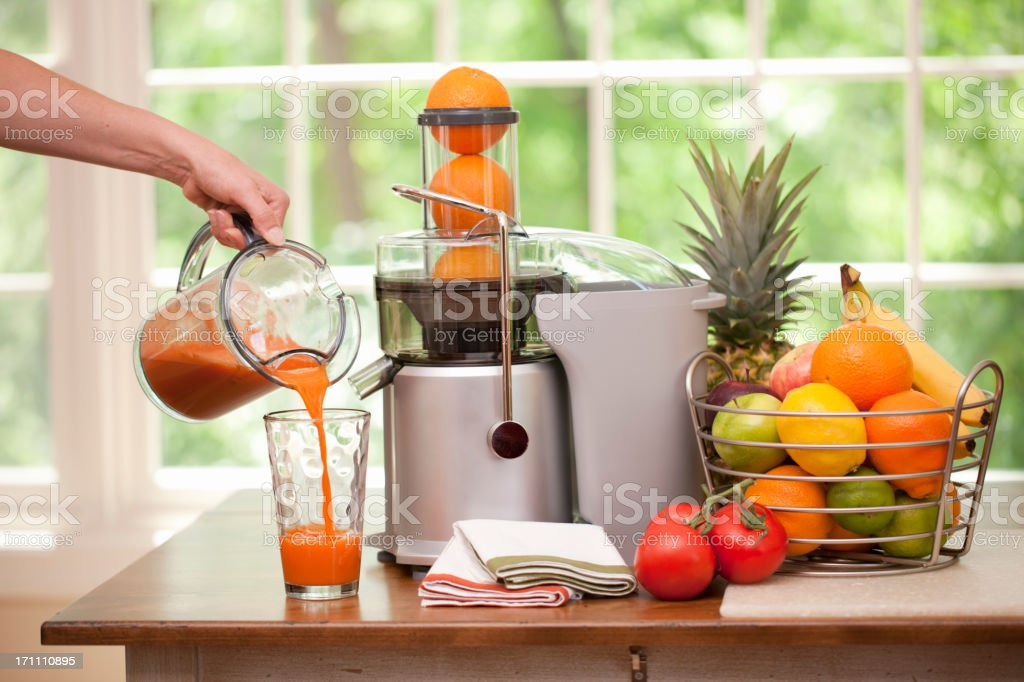 Pouring a Glass of Fresh Blended Organic Juice stock photo