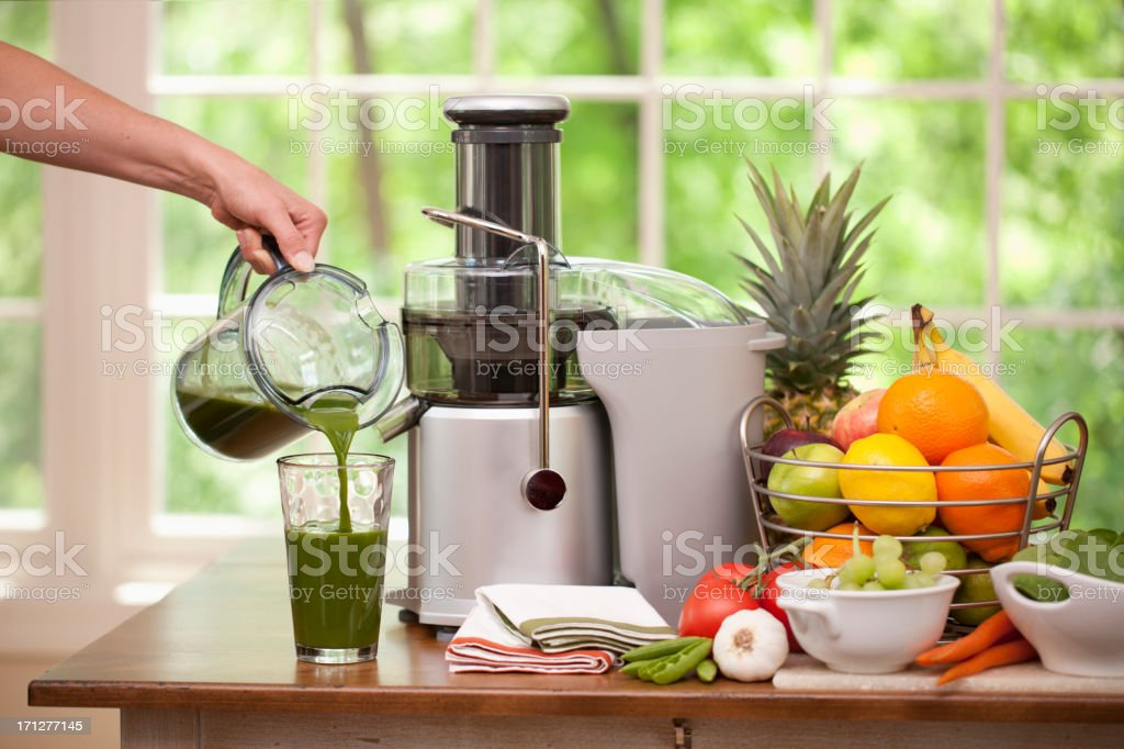 Pouring a Glass of  Fresh Organic Green Juice stock photo