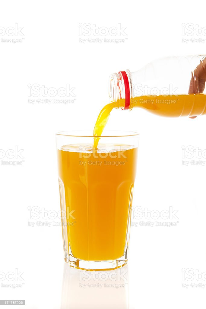 Pouring a glass of orange juice royalty-free stock photo