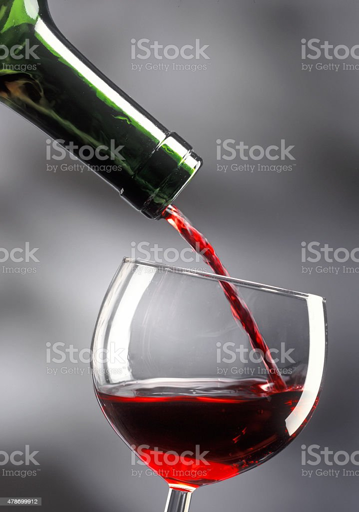 pouring a glass ofred wine stock photo