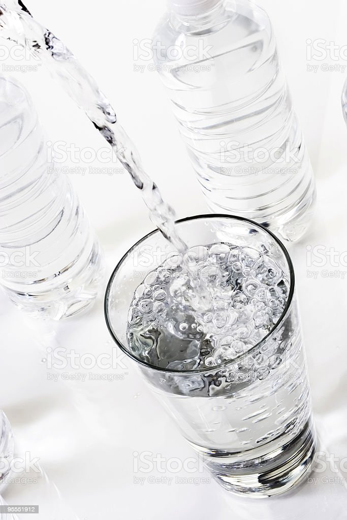 Pouring a glass of water royalty-free stock photo