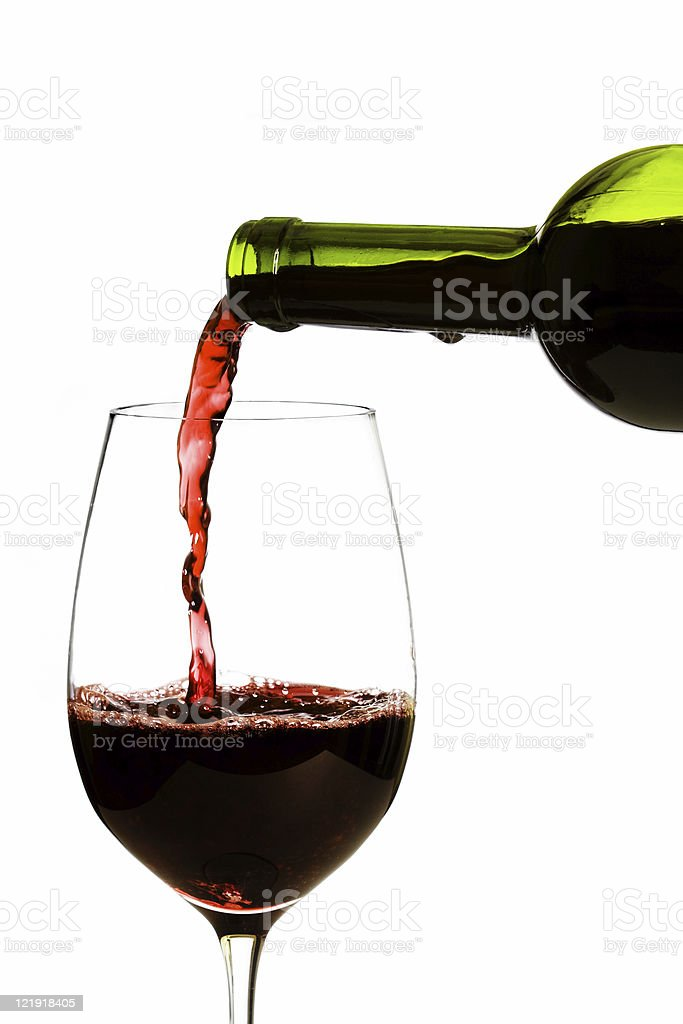 Pouring a glass of wine stock photo