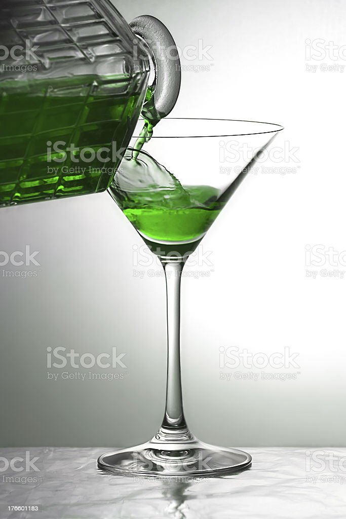 Pouring a green drink royalty-free stock photo