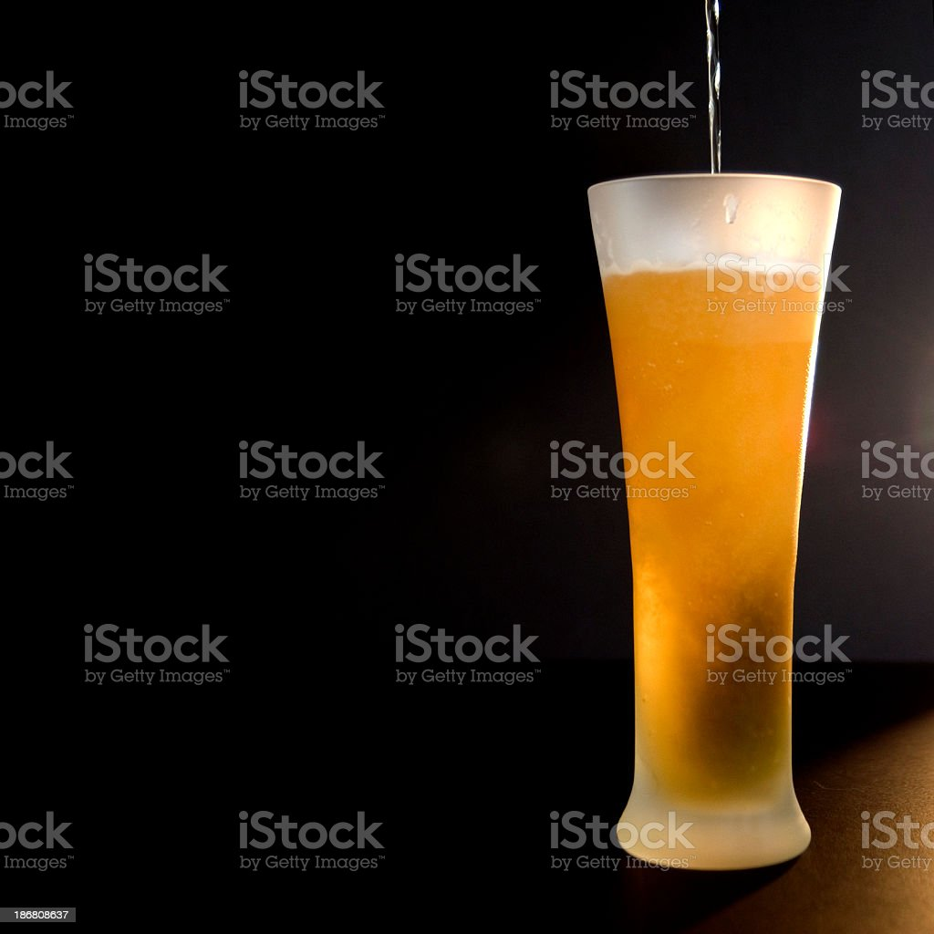 Pouring a Pint of Beer (with copy space) stock photo