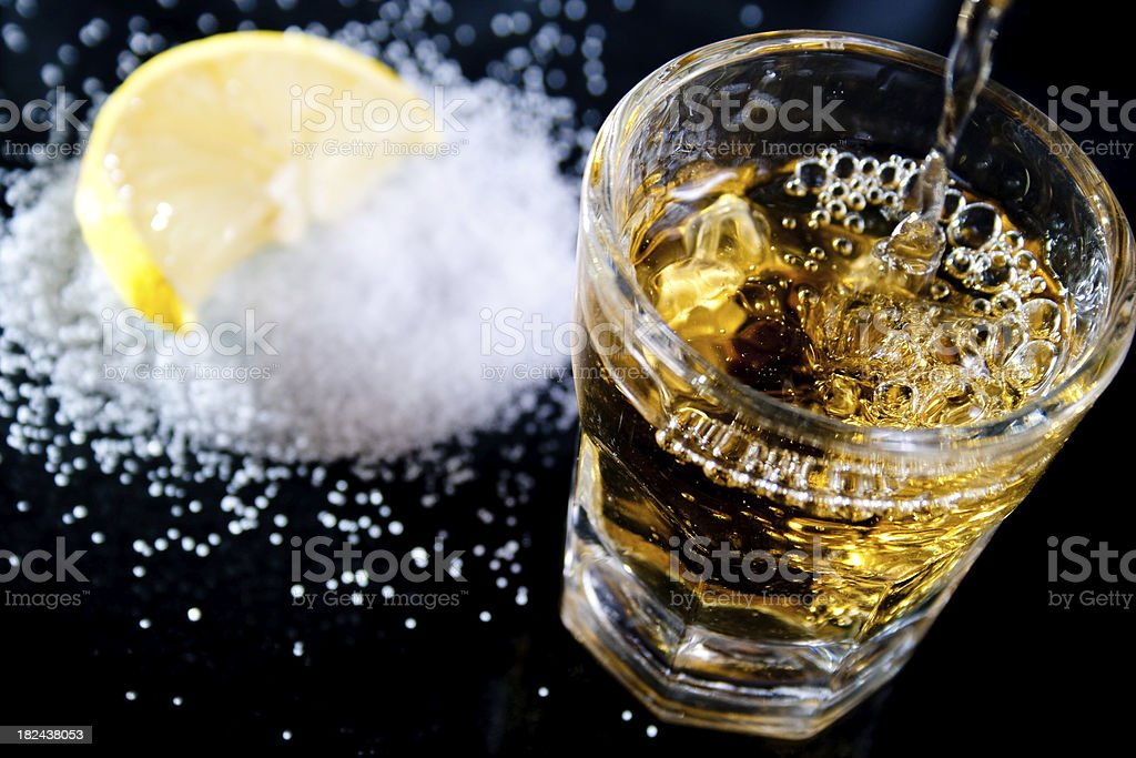 Pouring a tequila shot royalty-free stock photo