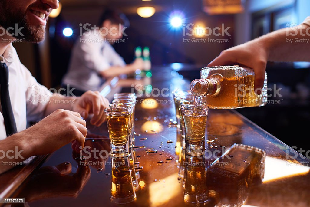 Pouring alcohol stock photo