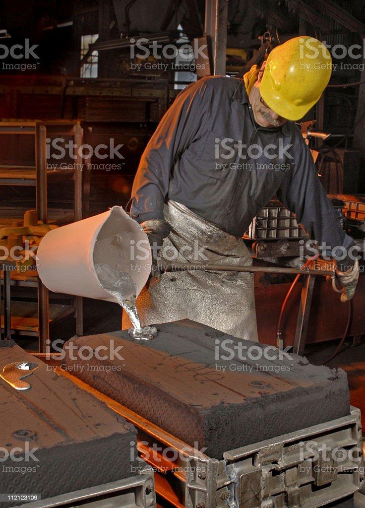 Pouring Aluminum stock photo
