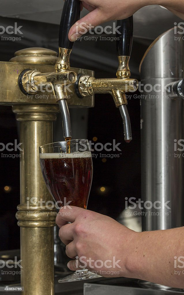 Pouring Beer From Tap stock photo