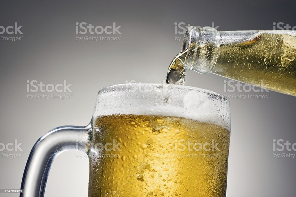 pouring beer royalty-free stock photo