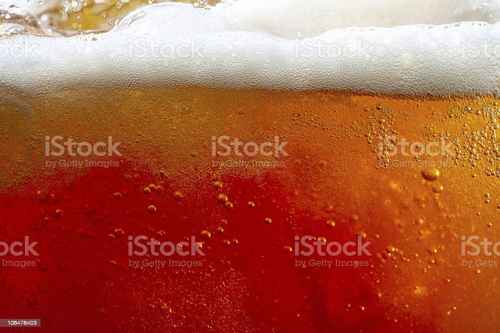 pouring beer with bubbles and froth stock photo