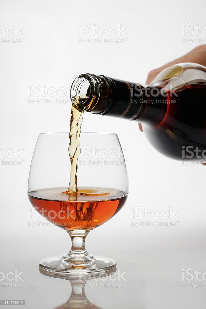 Pouring brandy to glass royalty-free stock photo