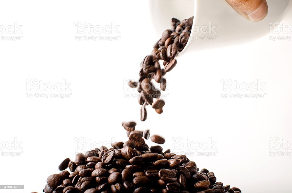 Pouring brown coffee beans stock photo