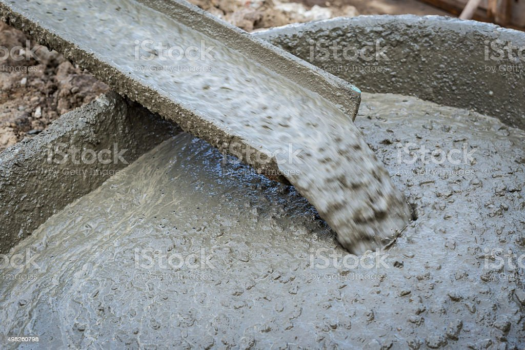 Pouring cement during for construction stock photo