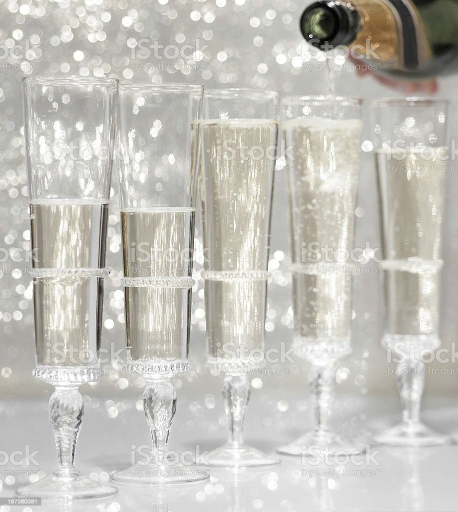 Pouring champagne in vintage glasses royalty-free stock photo
