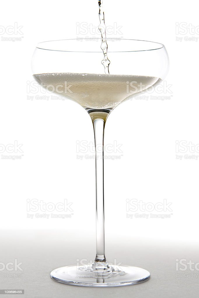 Pouring Champagne into a Glass royalty-free stock photo