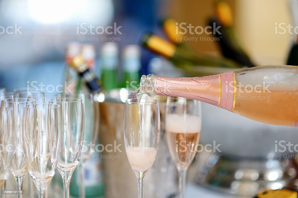 Pouring champagne into a glasses stock photo
