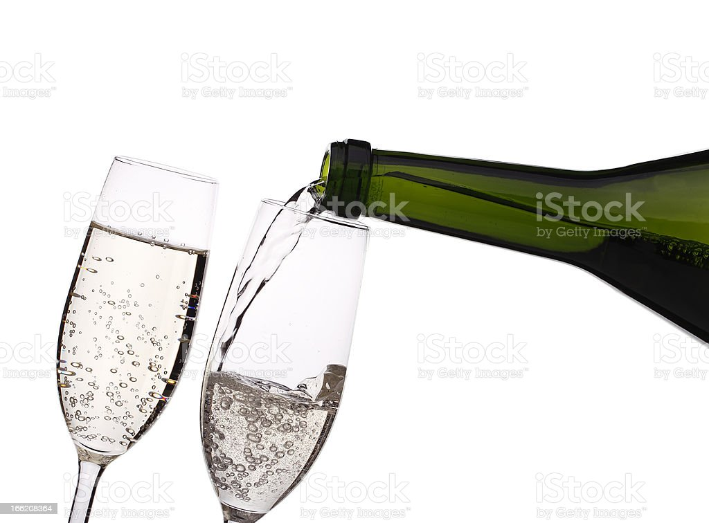 Pouring champagne into the glass royalty-free stock photo
