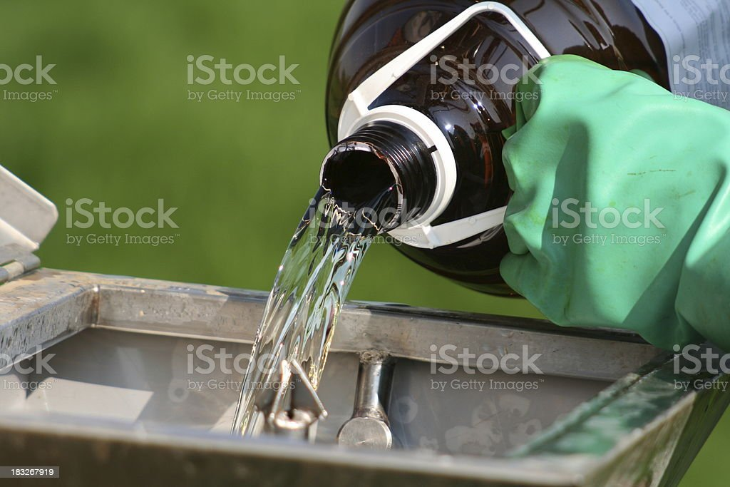 Pouring Chemical stock photo