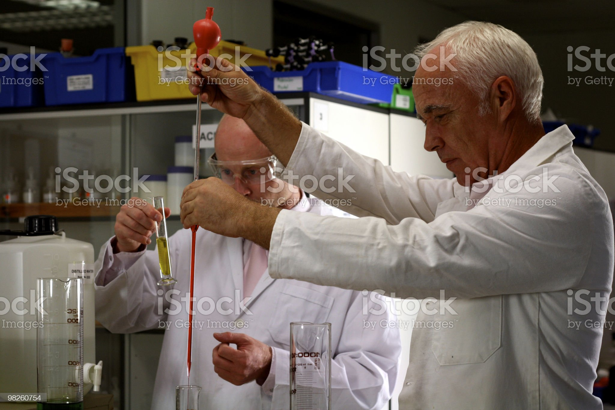 Pouring Chemicals royalty-free stock photo