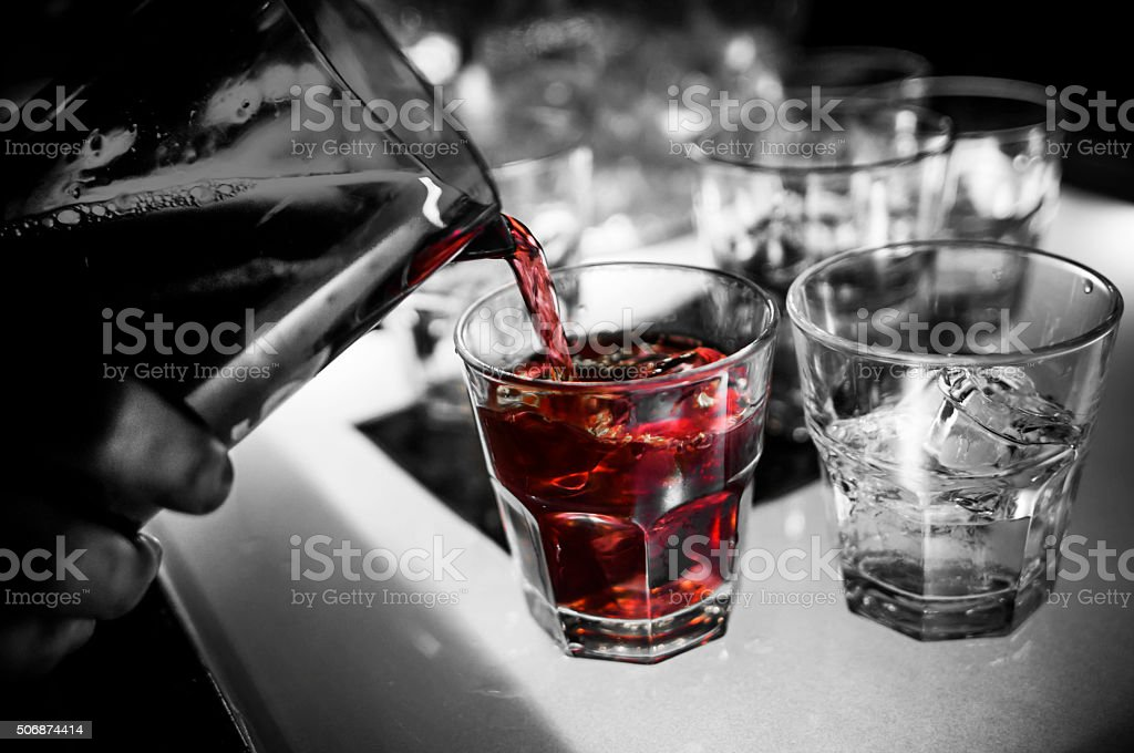 Pouring Cocktail into Glasses stock photo
