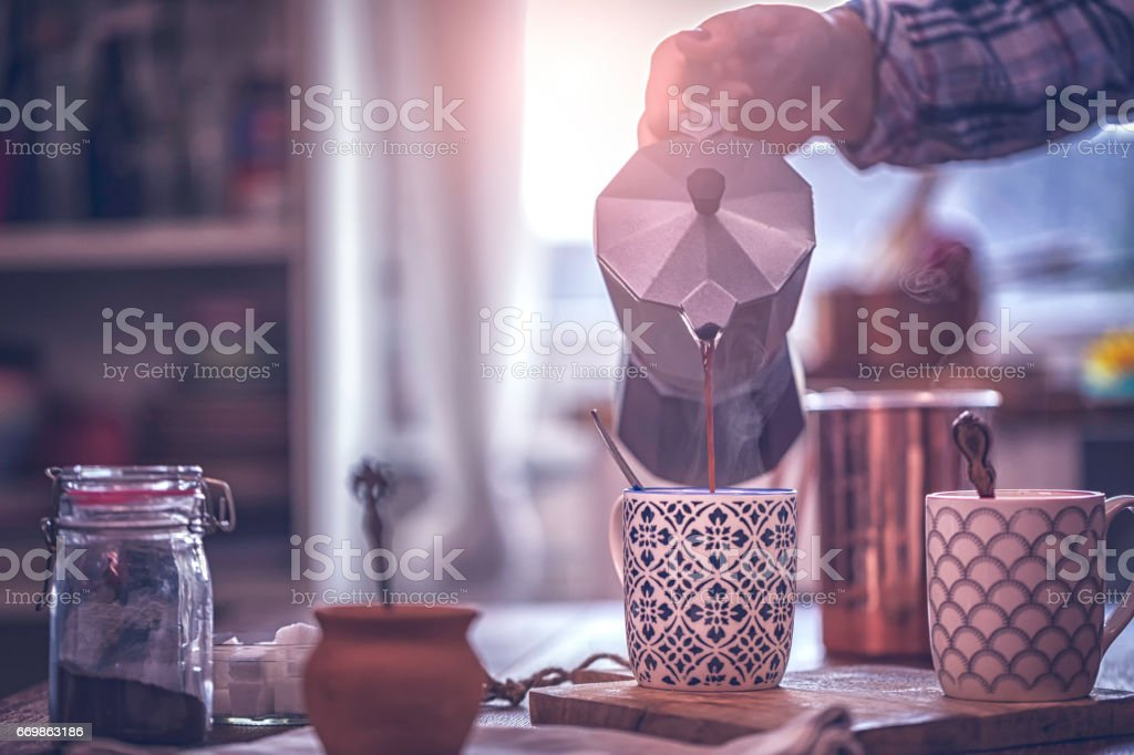 Pouring Coffee into Coffee Cup stock photo
