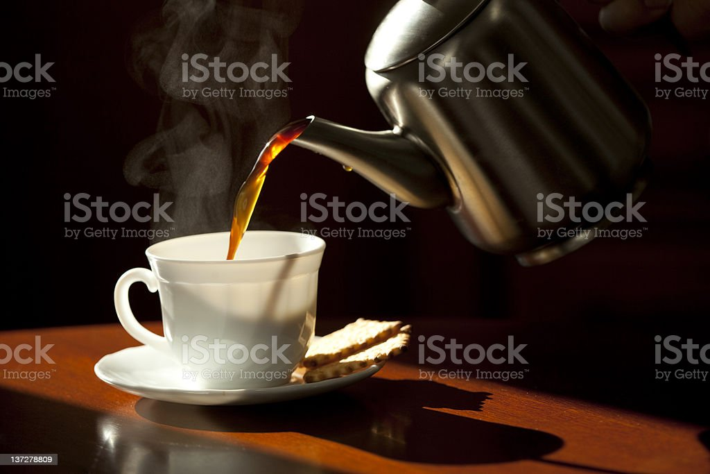 Pouring coffee into the white cup . royalty-free stock photo