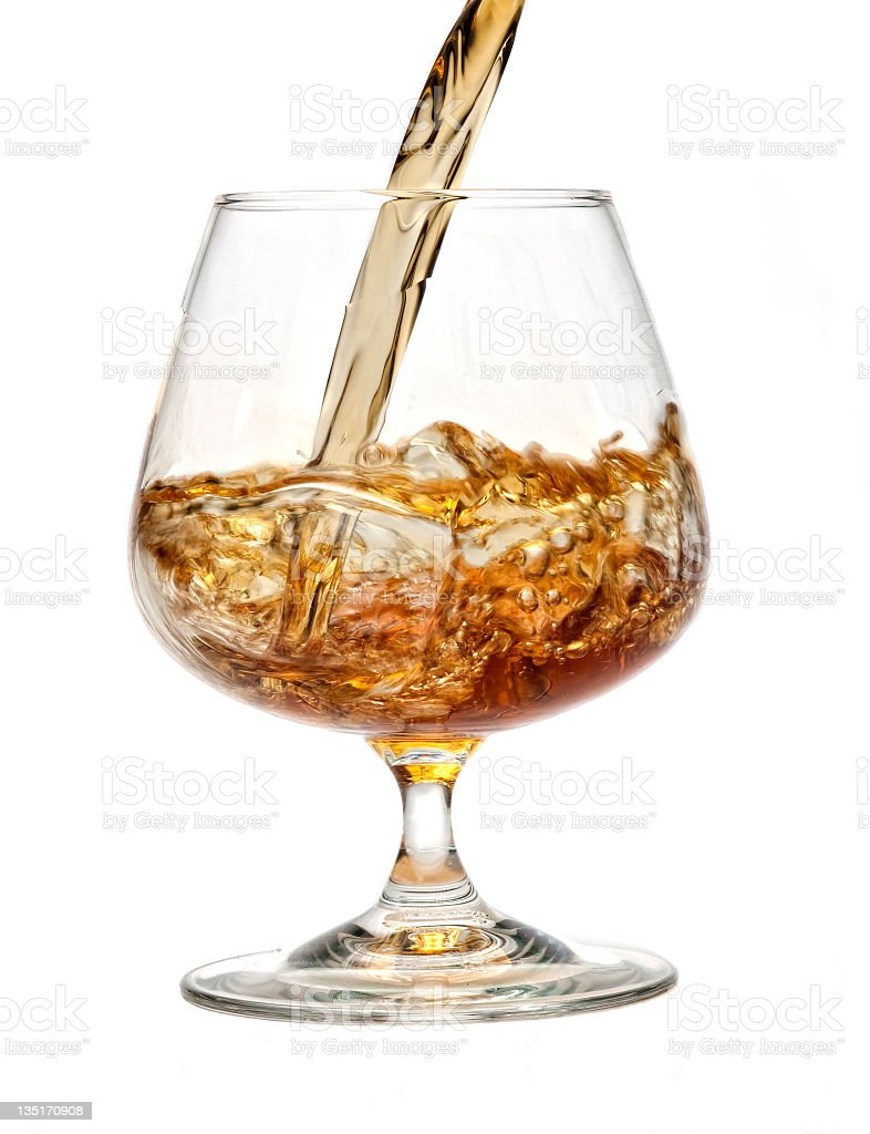 Pouring Cognac to glass royalty-free stock photo