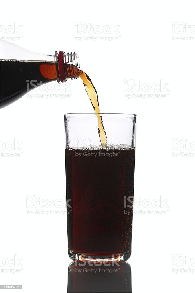 Pouring Cola into Glass stock photo