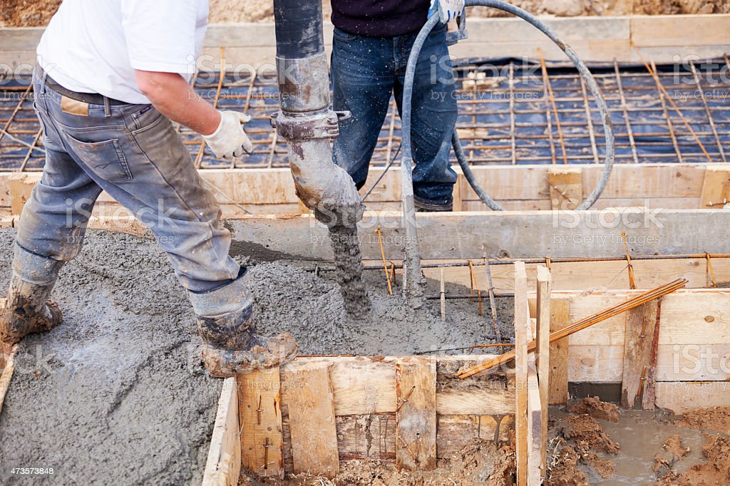 Pouring Concrete Foundation Footer stock photo