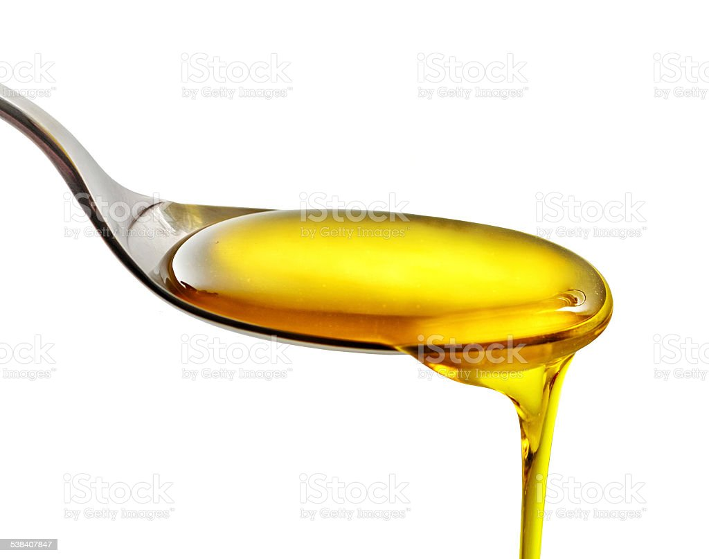 pouring cooking oil stock photo