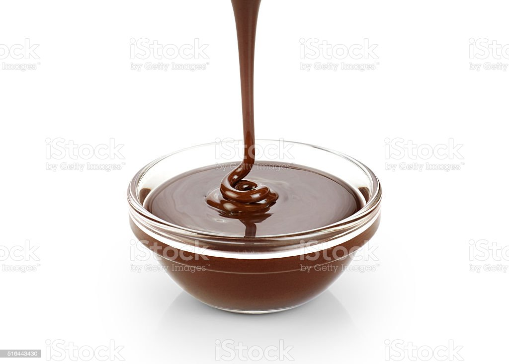 Pouring dark melted chocolate isolated on white background. stock photo