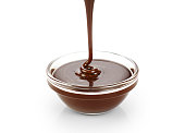 Pouring dark melted chocolate isolated on white background.