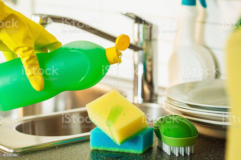 pouring dishwashing liquid on sponge kitchen wash cleaning stock photo