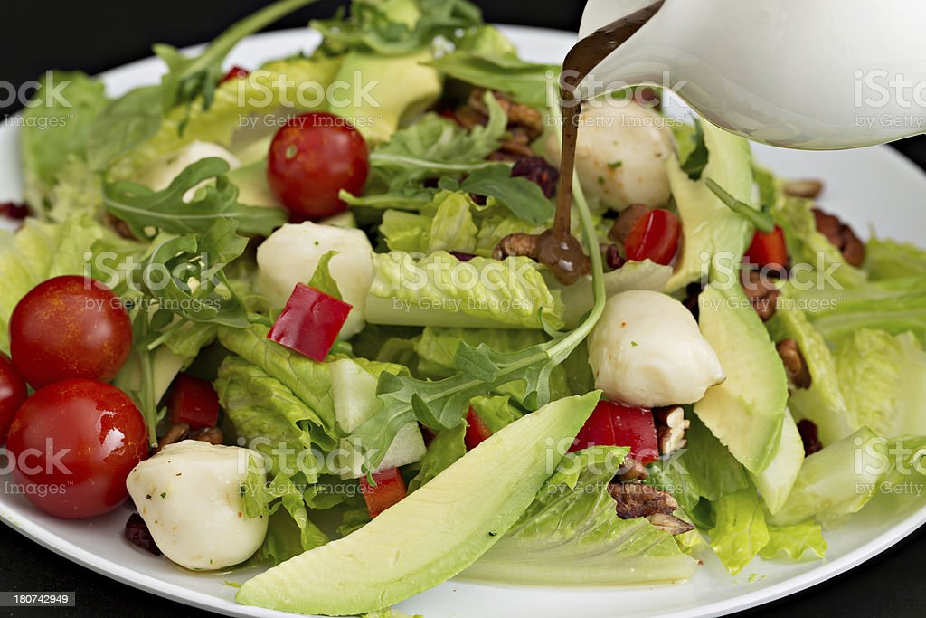 Pouring Dressing On A Green Salad royalty-free stock photo