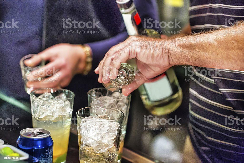 Pouring drinks for a holiday party on New year's Eve royalty-free stock photo