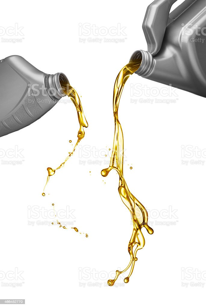 pouring engine oil stock photo