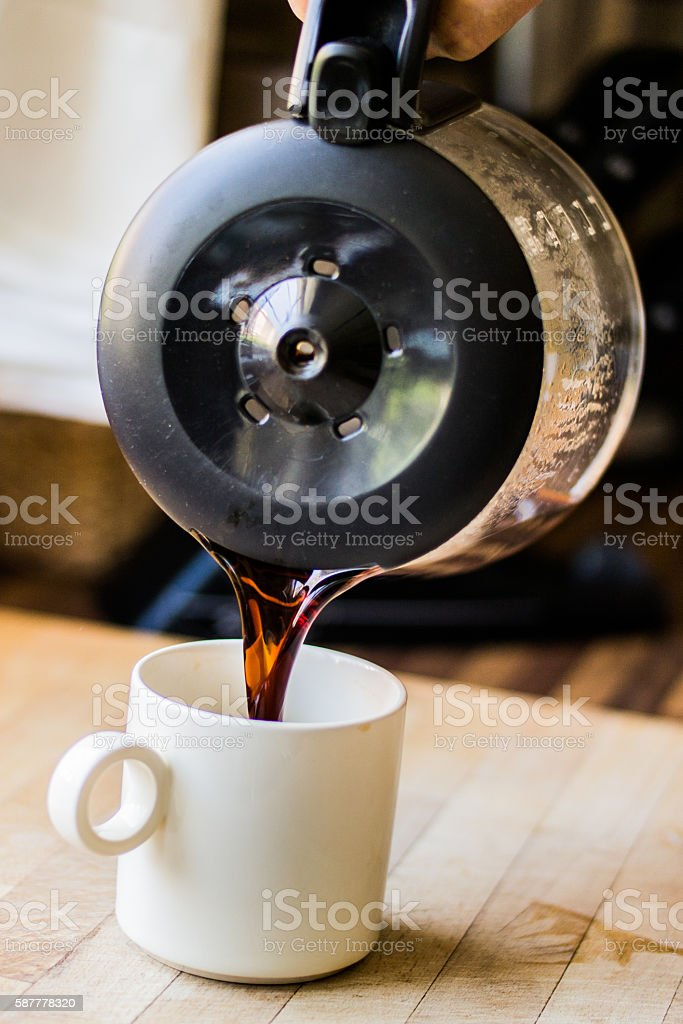 Pouring filter coffee stock photo