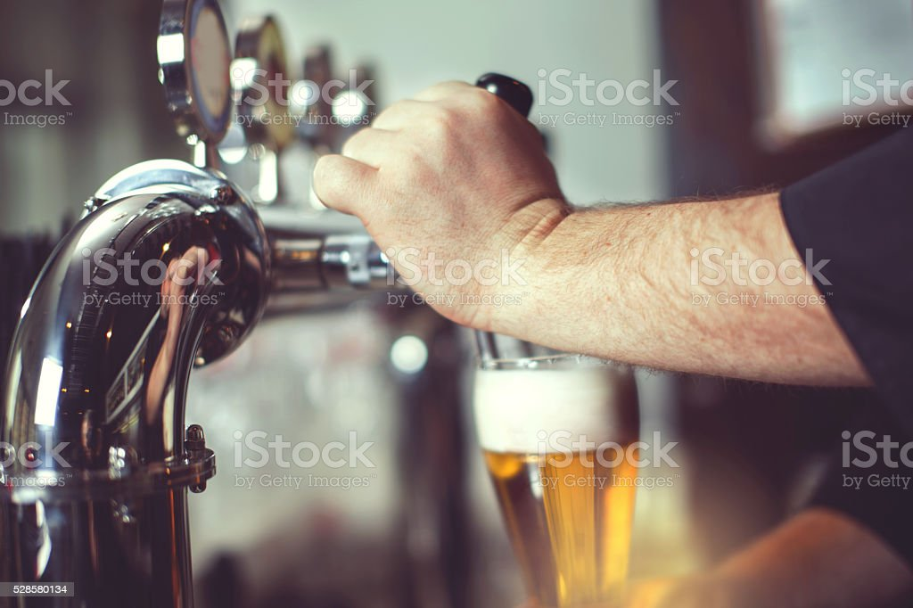 Pouring fresh beer. stock photo