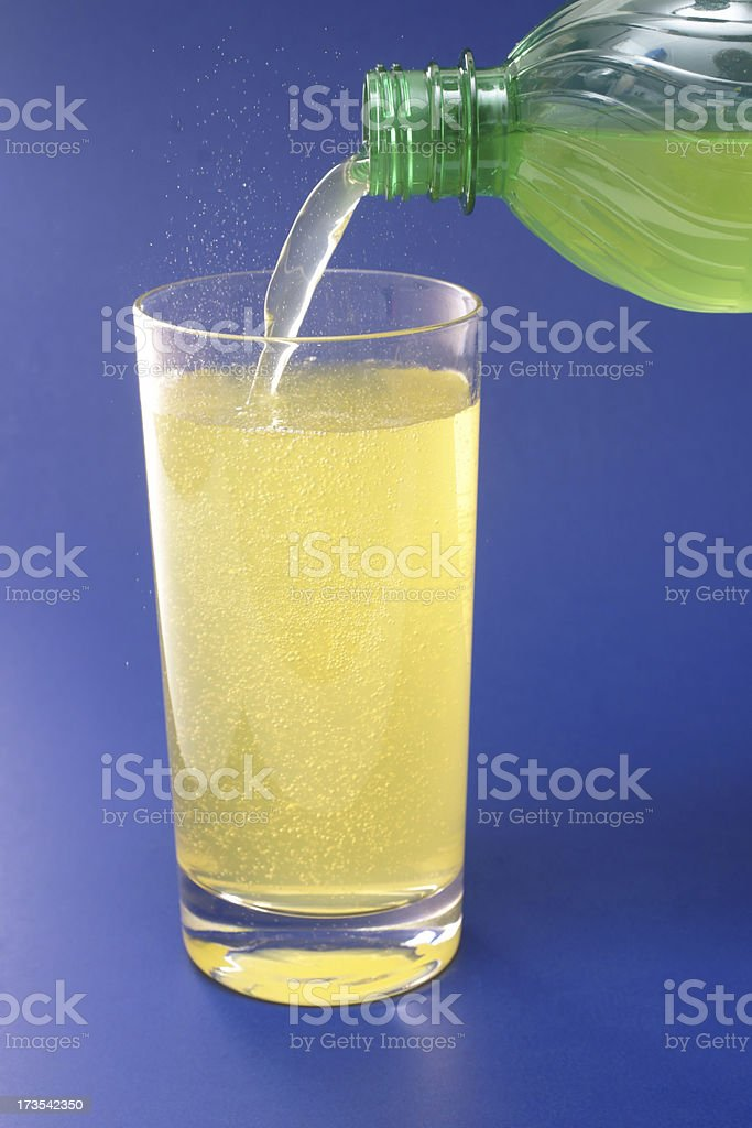 pouring glass of soda stock photo