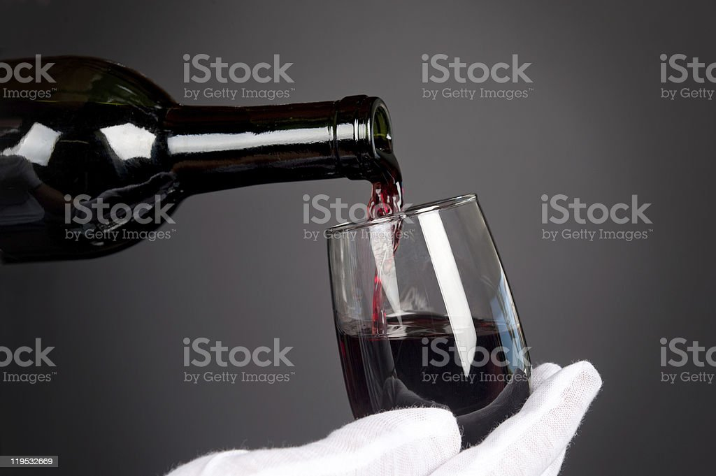 Pouring glass of wine royalty-free stock photo