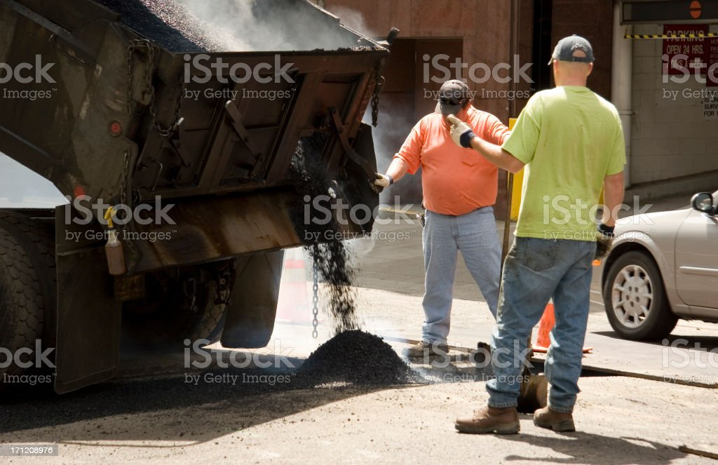 Pouring Hot Ashfalt in the City royalty-free stock photo