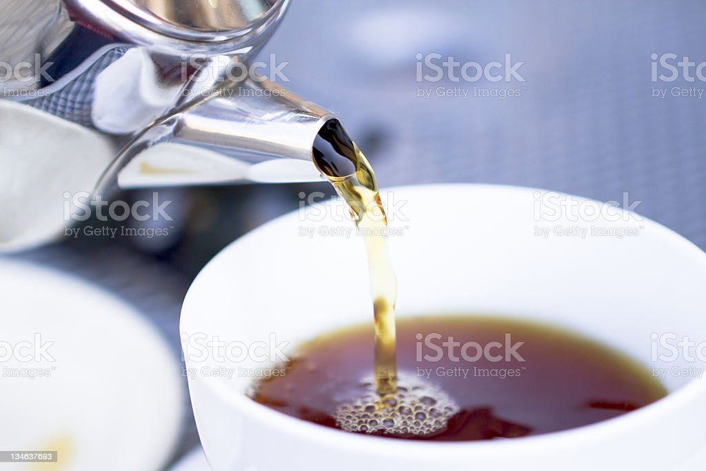 Pouring Hot Tea From Restaurant Style Cattle royalty-free stock photo