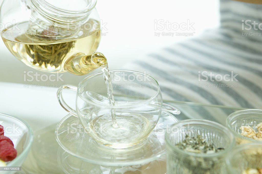 Pouring jasmine tea stock photo