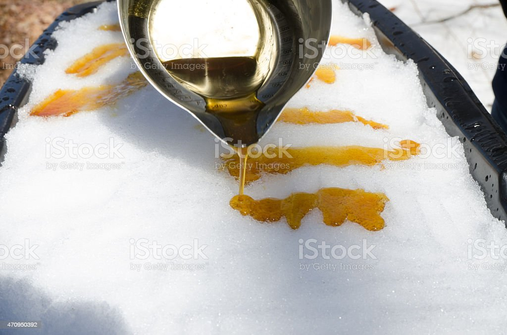 Pouring maple taffy stock photo