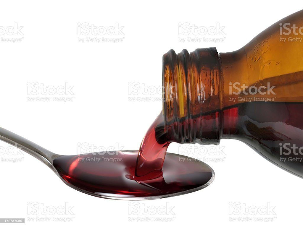 Pouring medicine royalty-free stock photo