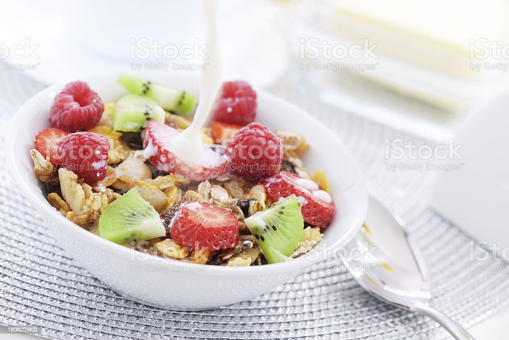 Pouring milk on a bowl of cereal royalty-free stock photo