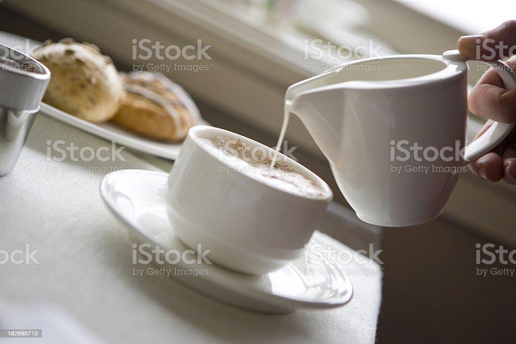 Pouring milk royalty-free stock photo