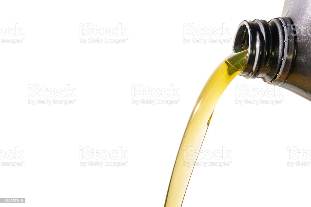 Pouring motor oil on white background stock photo