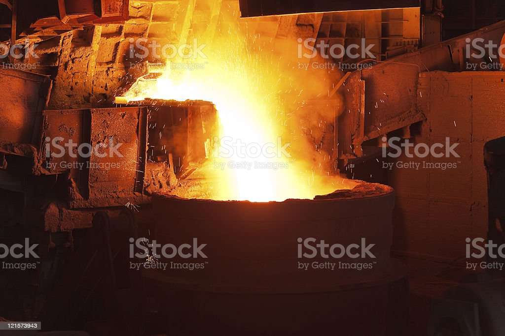 Pouring of liquid metal in open hearth workshop stock photo